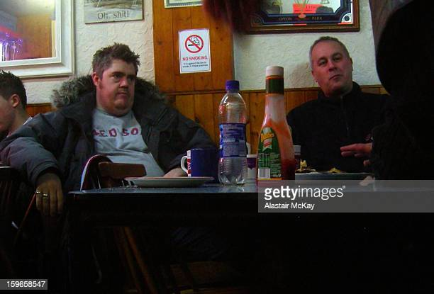 West Ham fans comedian Phill Jupitus and broadcaster/publisher Iain Dale in Ken's Cafe, Green Street, before a match at nearby Upton Park.