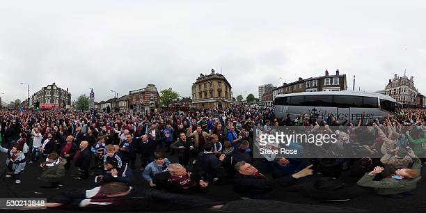 West Ham fans enjoy the atmosphere outside the stadium prior to the Barclays Premier League match between West Ham United and Manchester United at...