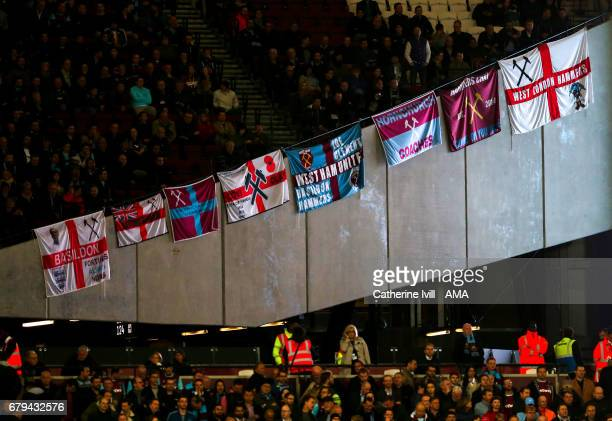 West Ham fans hang their flags during the Premier League match between West Ham United and Tottenham Hotspur at London Stadium on May 5, 2017 in...