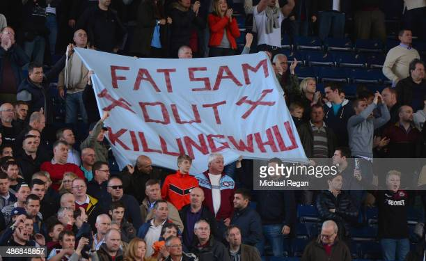 West Ham fans hold up a banner to West Ham manager Sam Allardyce during the Barclays Premier League match between West Bromwich Albion and West Ham...