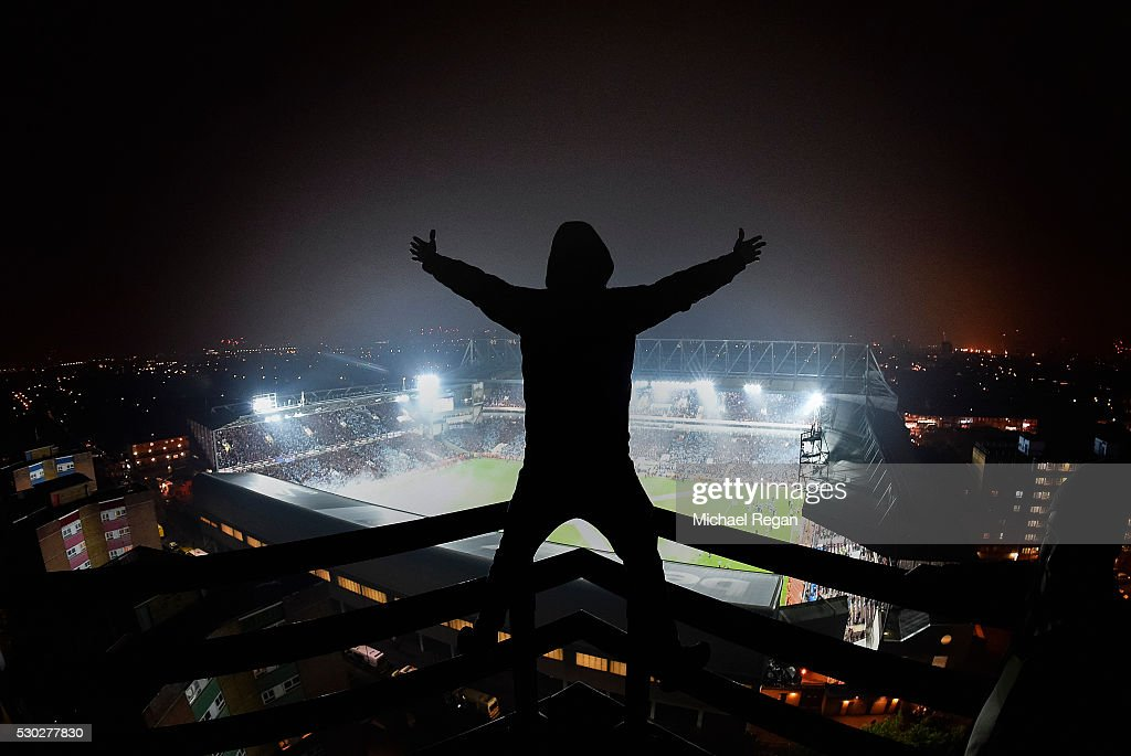 A West Ham fans sings as he looks on from his vantage point during the Barclays Premier League match between West Ham United and Manchester United at the Boleyn Ground on May 10, 2016 in London, England. West Ham United are playing their last ever home match at the Boleyn Ground after their 112 year stay at the stadium. The Hammers will move to the Olympic Stadium for the 2016-17 season.