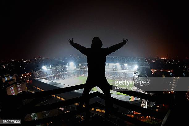 West Ham fans sings as he looks on from his vantage point during the Barclays Premier League match between West Ham United and Manchester United at...