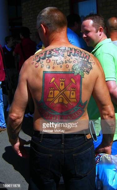 West Ham football fan shows his support outside the club;s stadium, the Boleyn Ground , London.