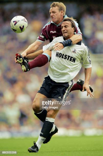 West Ham full back Stuart Pearce challenges David Ginola of Spurs during an FA Premiership match at Upton Park on August 7 1999 in London England