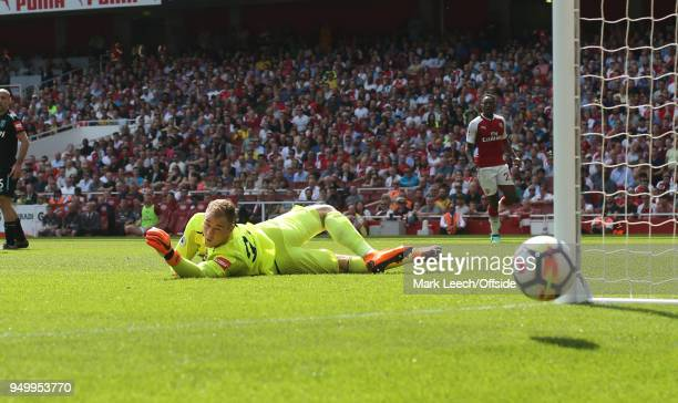 West Ham goalkeeper Joe Hart makes a save during the Premier League match between Arsenal and West Ham United at Emirates Stadium on April 22 2018 in...