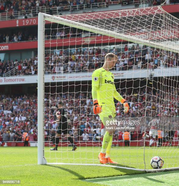 West Ham goalkeeper Joe Hart retrieves the ball from his net after the third Arsenal goal during the Premier League match between Arsenal and West...