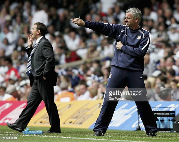 West Ham manager Alan Pardew points the way as Preston boss Billy Davies encourages his side during the Coca Cola Championship Play Off Final match...