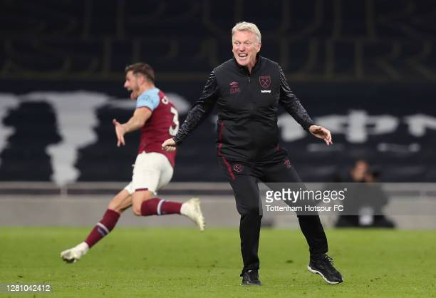 West Ham manager David Moyes celebrates after their third goal during the Premier League match between Tottenham Hotspur and West Ham United at...