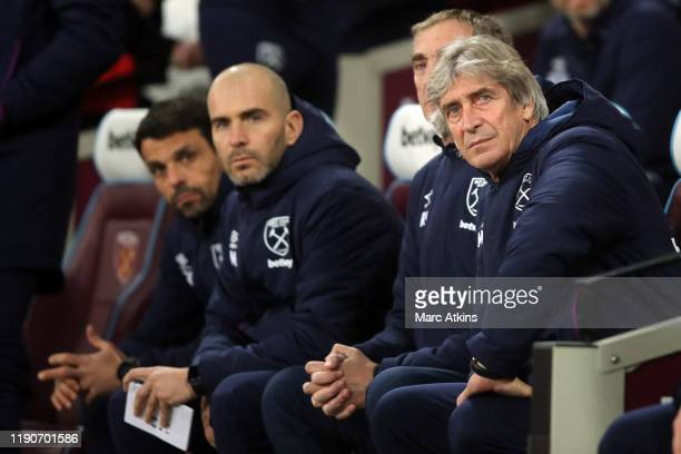 West Ham manager Manuel Pellegrini among his coaching staff during the Premier League match between West Ham United and Leicester City at London...