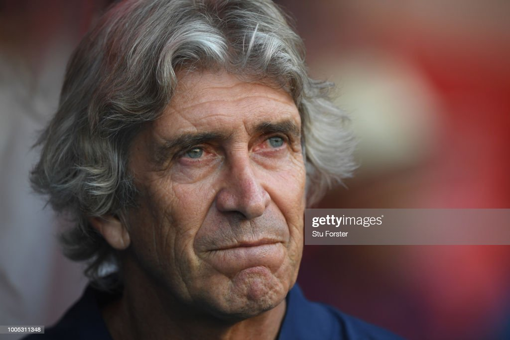 West Ham manager Manuel Pellegrini looks on during a friendly match between Aston Villa and West Ham United at Banks' Stadium on July 25, 2018 in Walsall, England.