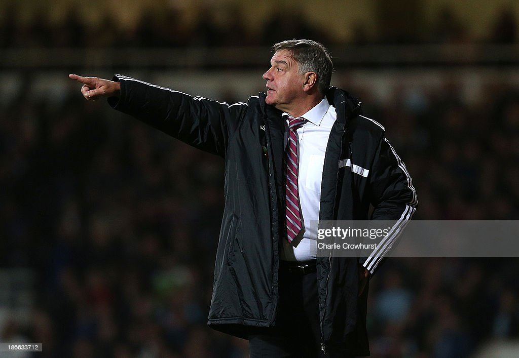 West Ham manager Sam Allardyce gives out orders to his team during the Barclays Premier League match between West Ham United and Aston Villa at Upton Park on November 02, 2013 in London, England.