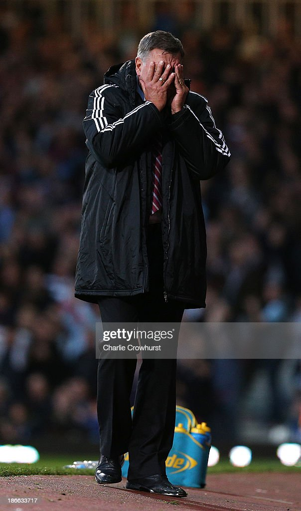 West Ham manager Sam Allardyce turns away after the team go close to a goal during the Barclays Premier League match between West Ham United and Aston Villa at Upton Park on November 02, 2013 in London, England.