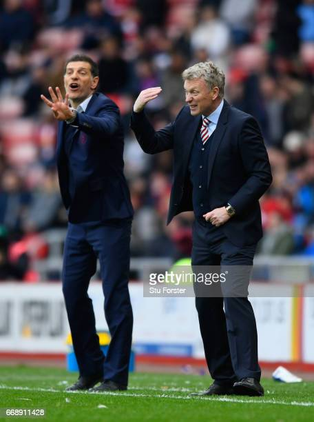 West Ham manager Slaven Bilic and David Moyes of Sunderland react during the Premier League match between Sunderland and West Ham United at Stadium...