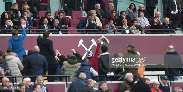 West Ham owner David Gold tries to ignore protesting fans gathering on the concourse below during the Premier League match between West Ham United...