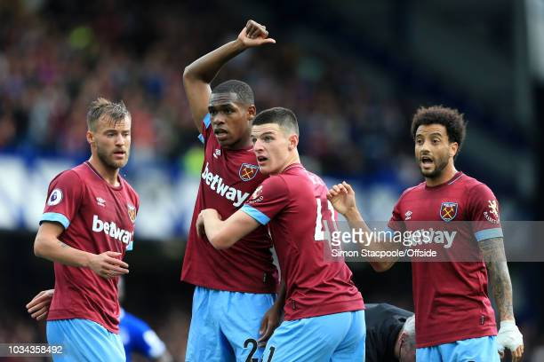 West Ham players Andriy Yarmolenko Issa Diop Declan Rice and Felipe Anderson of West Ham gesture during the Premier League match between Everton and...