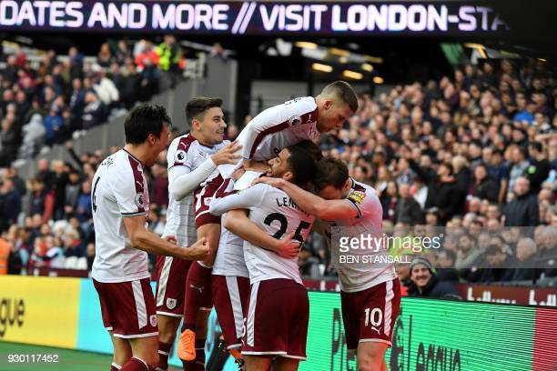 West Ham players celebrate after Burnley's New Zealand striker Chris Wood scored their second goal during the English Premier League football match...