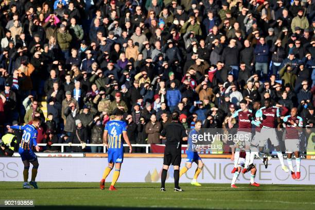 West Ham players defend a free kick from Shrewsbury Town's English midfielder Jon Nolan during the English FA Cup third round football match between...