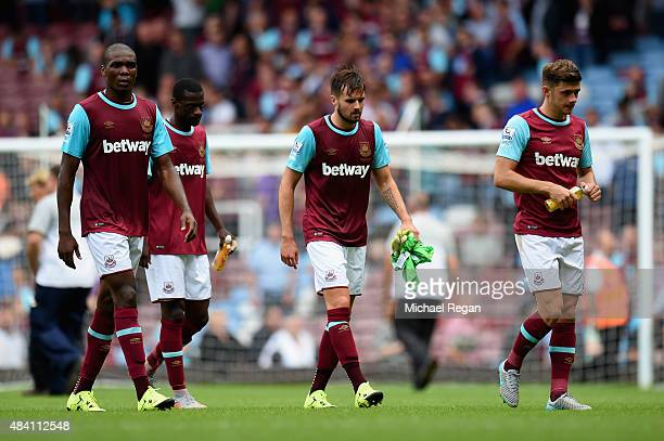 West Ham players look dejected after his team's 12 defeat in the Barclays Premier League match between West Ham United and Leicester City at the...