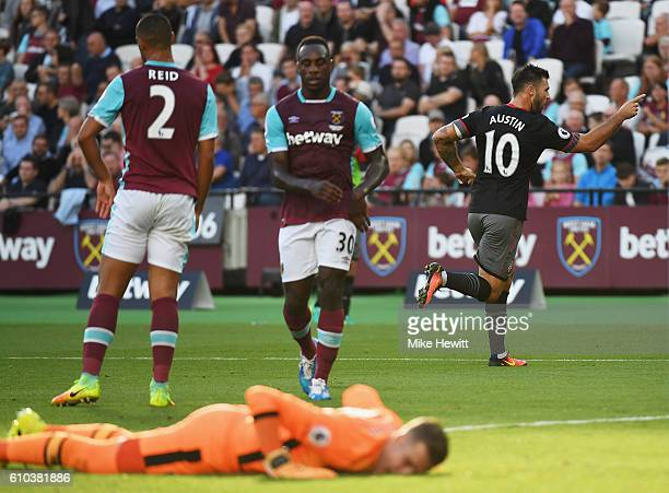 West Ham players look dejected as Charlie Austin of Southampton celebrates as he scores their first goal during the Premier League match between West...