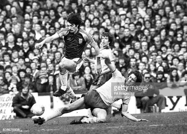 West Ham striker Alan Devonshire who scored the last of his side's goals during the 40 win over Chelsea leaps over the outstretched Colin Lee during...