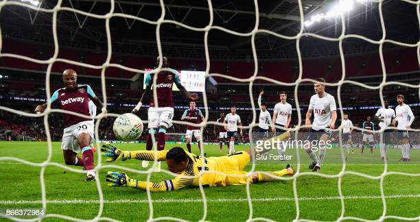 West Ham striker Andre Ayew scores the first West Ham goal past Michel Vorm during the Carabao Cup Fourth Round match between Tottenham Hotspur and...