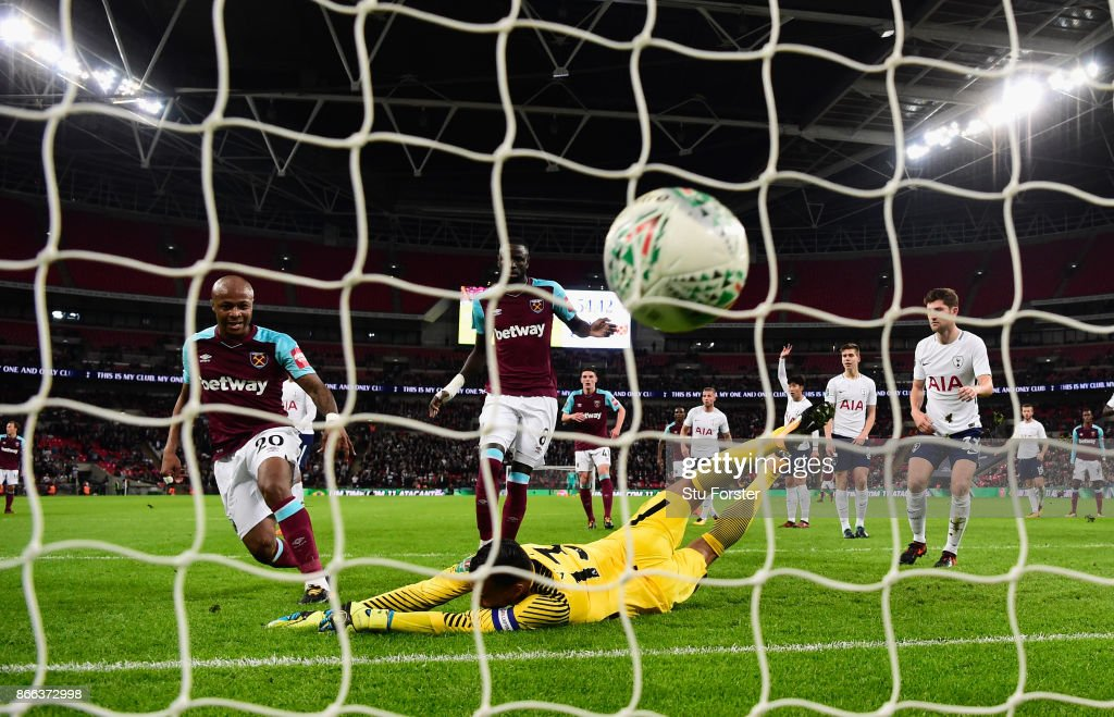 West Ham striker Andre Ayew scores the first West Ham goal past Michel Vorm during the Carabao Cup Fourth Round match between Tottenham Hotspur and West Ham United at Wembley Stadium on October 25, 2017 in London, England.
