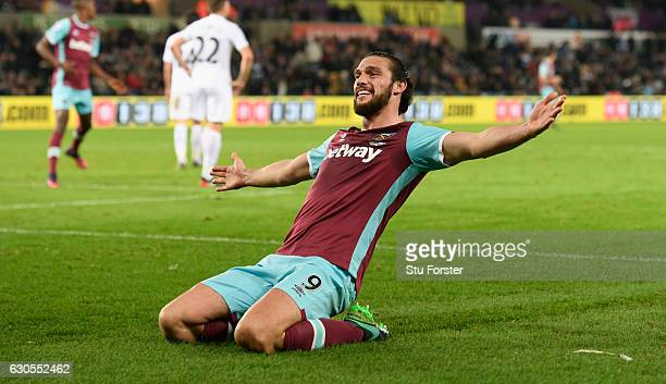 West Ham striker Andy Carroll celebrates after scoring the fourth West Ham goal during the Premier League match between Swansea City and West Ham...