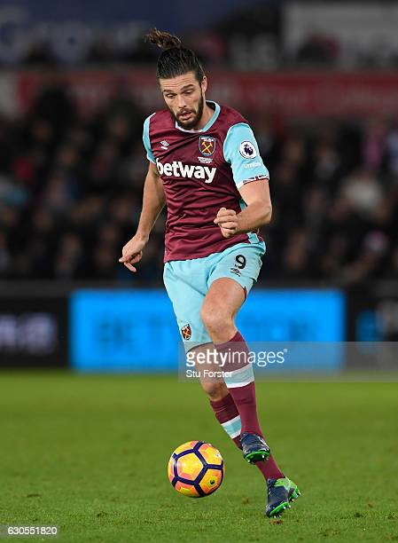 West Ham striker Andy Carroll in action during the Premier League match between Swansea City and West Ham United at Liberty Stadium on December 26...