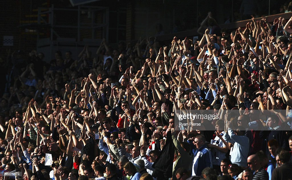 West Ham supporters cheer during the Barclays Premier League match between Aston Villa and West Ham United at Villa Park on April 18, 2009 in Birmingham, England.