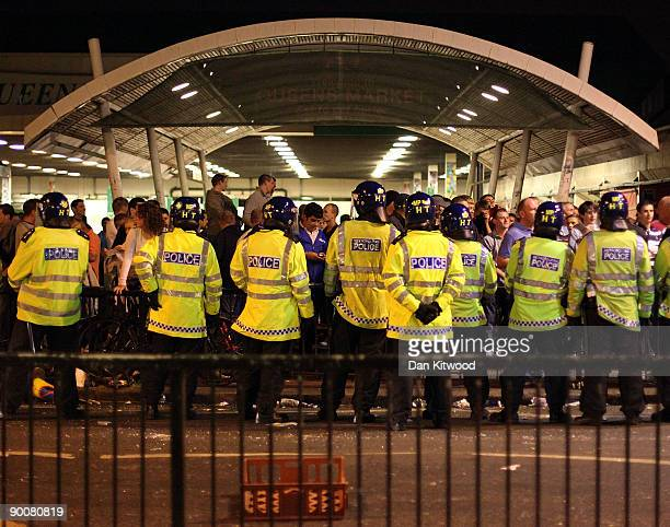 West Ham supporters confront riot police outside the West Ham football ground on August 25 2009 in London England Violence broke out between West Ham...