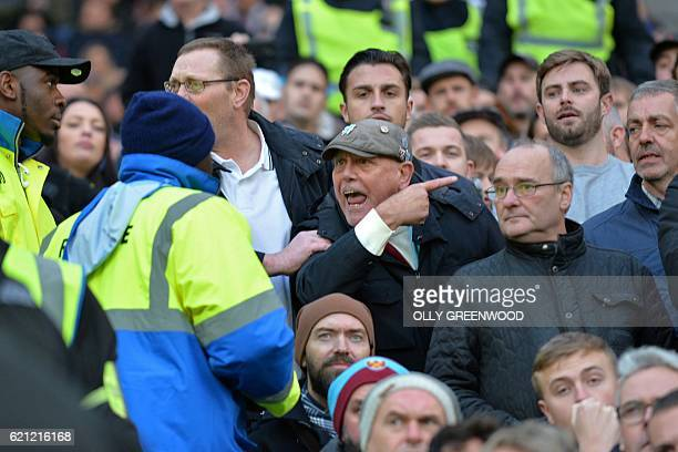 West Ham supporters confront stewards during the English Premier League football match between West Ham United and Stoke City at The London Stadium...