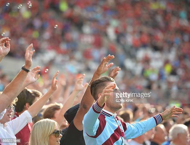 West Ham supporters singing during the English Premier League football match between West Ham United and Bournemouth at The London Stadium in east...