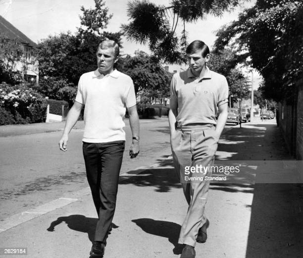 West Ham United and England football players Bobby Moore and Martin Peters taking a walk along a suburban street Original Publication People Disc...