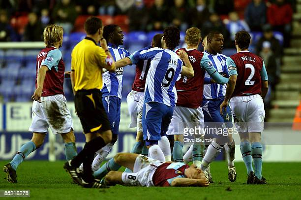 West Ham United and Wigan Athletic players fight after a bad tackle by Wigans Lee Cattermole on West Hams Scott Parker during the Barclays Premier...