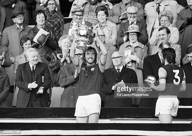 West Ham United captain Billy Bonds holds aloft the FA Cup trophy after West Ham defeated Fulham 20 in the FA Cup Final at Wembley Stadium in London...