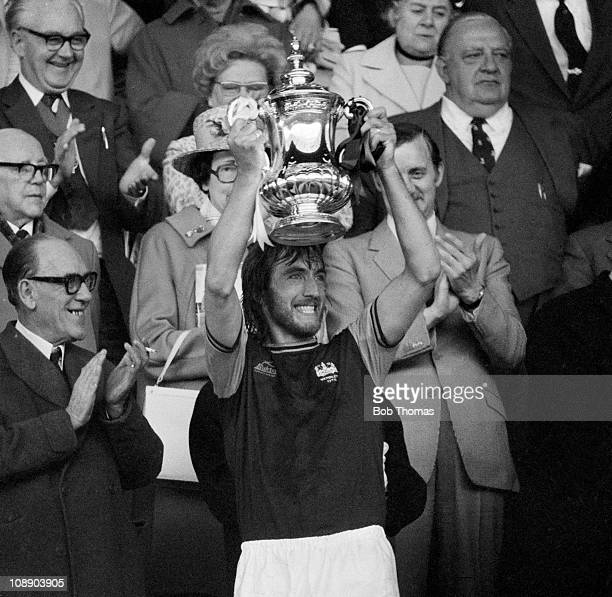 West Ham United captain Billy Bonds holds the FA Cup aloft after their 20 victory over Fulham in the FA Cup Final at Wembley Stadium London on 3rd...