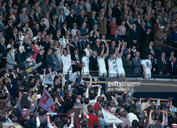 West Ham United captain Billy Bonds lifts the FA Cup in the Royal Box at Wembley Stadium after their 10 victory over Arsenal in the FA Cup Final 10th...