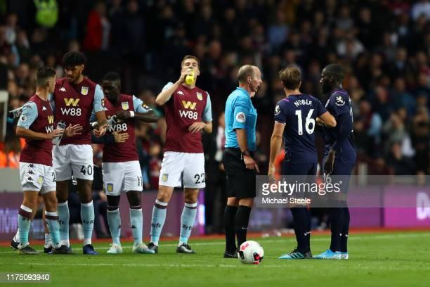 West Ham United Captain Mark Noble questions Referee Michael Dean as he sends off Arthur Masuaku of West Ham United during the Premier League match...
