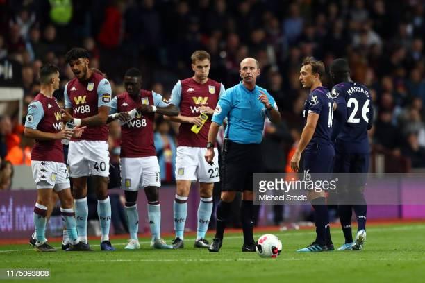 West Ham United Captain Mark Noble questions Referee Michael Dean after he sent off Arthur Masuaku of West Ham United during the Premier League match...