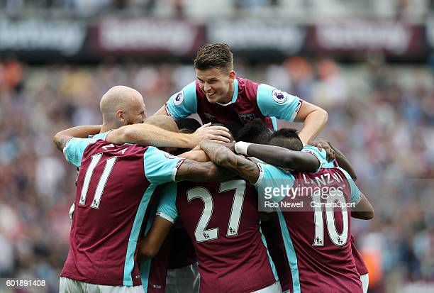 West Ham United celebrate their 1st goal scored by Michail Antonio and assisted by Dimitri Payet during the Premier League match between West Ham...