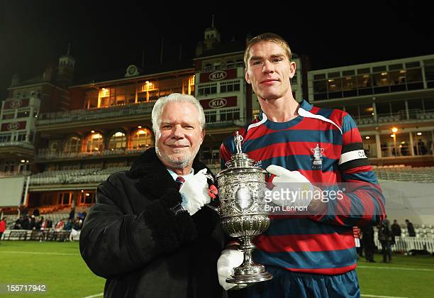 West Ham United Chairman David Gold poses with the first ever FA Cup and Royal Engineers AFC Captain Jay Hubbard after winning the First FA Cup Final...