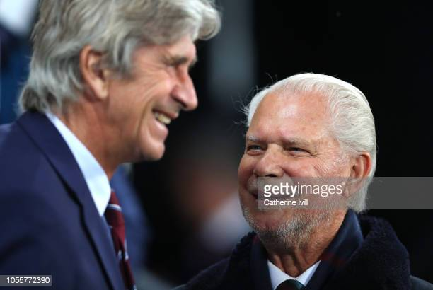 West Ham United co-chairman David Gold speaks with Manuel Pellegrini, Manager of West Ham United prior to the Carabao Cup Fourth Round match between...