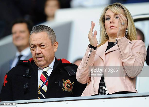 West Ham United co-owner David Sullivan and his wife look on during the Barclays Premier League match between Tottenham Hotspur and West Ham United...