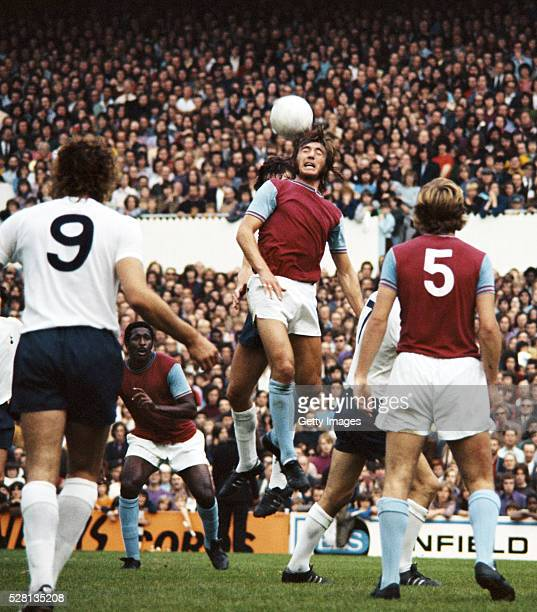 West Ham United defender Billy Bonds wins a header during a First Division match against Tottenham Hotspur at White Hart Lane on September 23 1972 in...