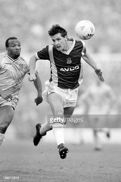 West Ham United defender Tony Gale under pressure from Coventry City striker Cyrille Regis during their First Division match at Highfield Road in...