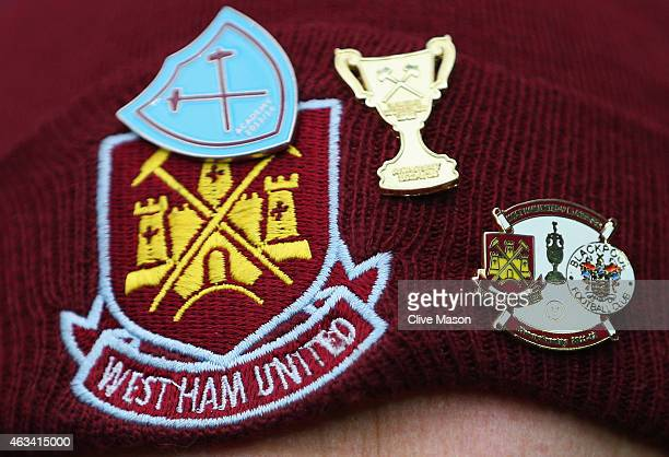 West Ham United fan displays his pin badges prior to the FA Cup Fifth Round match between West Bromwich Albion and West Ham United at The Hawthorns...
