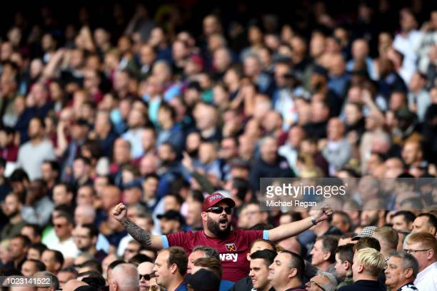 West Ham United fan enjoys the atmosphere during the Premier League match between Arsenal FC and West Ham United at Emirates Stadium on August 25...