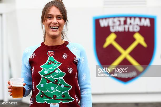 West Ham United fan gets the festive mood with a Christmas jumper outside the stadium prior to the Premier League match between West Ham United and...