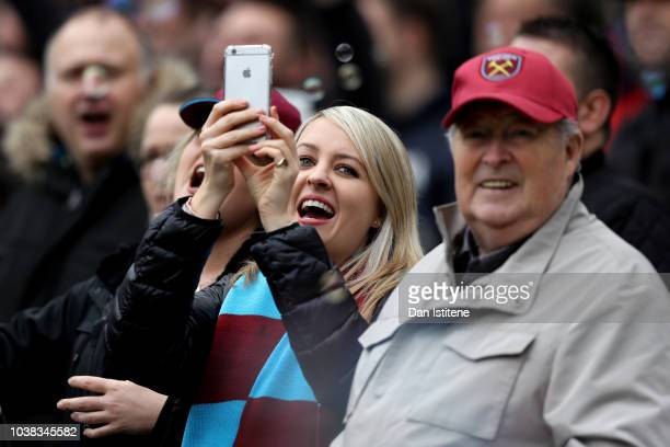 West Ham United fan is seen using their phone prior to the Premier League match between West Ham United and Chelsea FC at London Stadium on September...