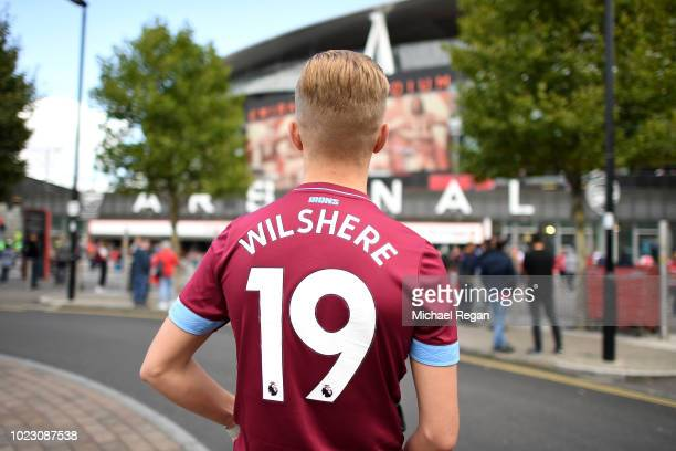 West Ham United fan is seen wearing a Jack Wilshere shirt outside the stadium prior to the Premier League match between Arsenal FC and West Ham...
